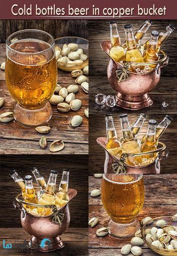 https://img5.downloadha.com/AliGh/IMG/Cold-bottles-beer-in-copper-bucket-Stock.jpg